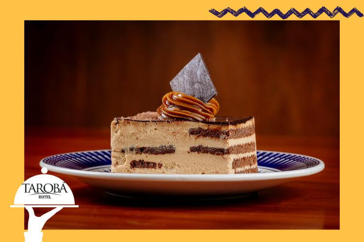 Uma ilustração da chocotorta, uma das comidas típicas da Argentina também, deliciosa sobremesa.